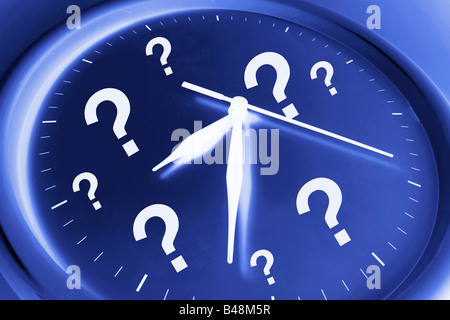 Wall Clock with Question Marks - Stock Photo