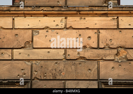Bullet holes from World War II on a wall in the centre of Berlin - Stock Photo