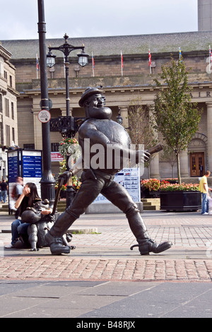Female tourist sitting beside Desperate Dan famous Scottish Wild West character on a sunny day in the city centre - Stock Photo