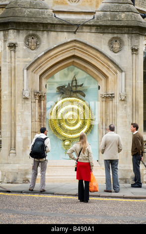 Tourists admire the new Grasshopper or Corpus Christi Clock, Kings Parade, cambridge UK - Stock Photo