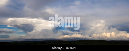 A 2 picture stitch panoramic of this mass of cumulonimbus clouds about 150 km north of Brasilia. - Stock Photo