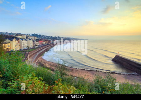 Sunrise overlooking the beach at Dawlish in South Devon - Stock Photo