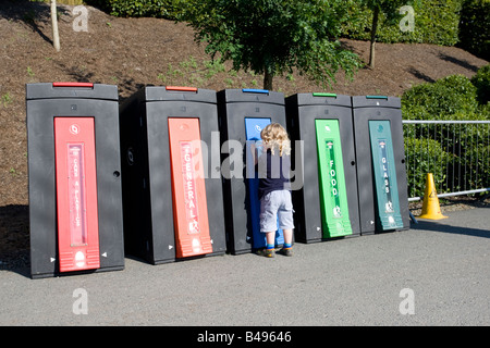 Colourful recycling bins Eden Project Bodelva St Austell Cornwall UK - Stock Photo