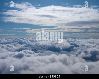 Flying above the clouds Picture taken at 19000 feet above the English Channel - Stock Photo