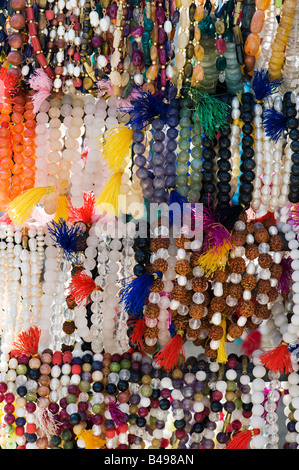 Wrist japamalas or religious counting beads hanging from a market stall in India