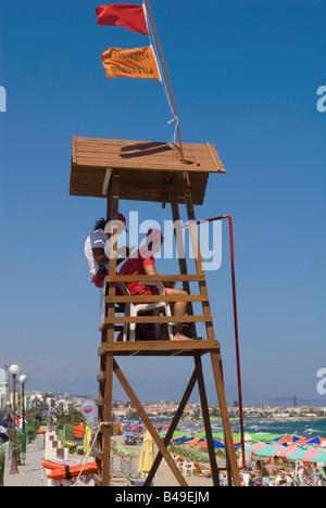 Lifeguards keep watch on Rethymnon Beach Crete - Stock Photo