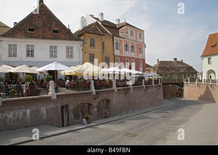 Sibiu Hermannstadt Transylvania Romania Europe EU September Cafes in the smaller square Piata Mica Casa Luxemburg - Stock Photo