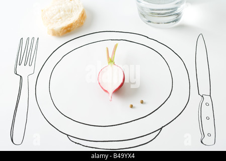 Half a radish and two peppercorns on plate, bread nearby - Stock Photo