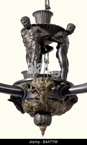 A bronze ceiling light., Three arms in cornucopia form with male heads in relief circumferentially around the rim - Stock Photo