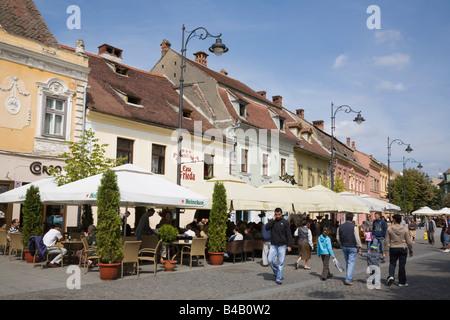 Sibiu Transylvania Romania Street cafes with umbrellas and outdoor seating on pedestrian precinct in historic city - Stock Photo