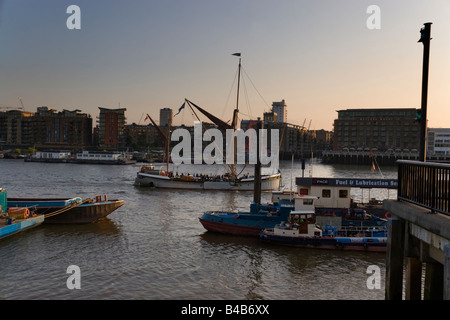 A Thames sailing barge taking Tourists up the River Thames in London in the early evening View is looking towards - Stock Photo