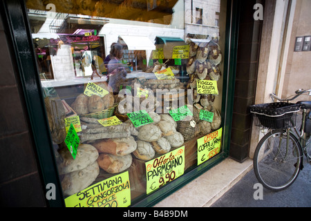 Ham and cheese shop in Parma, Italy - Stock Photo
