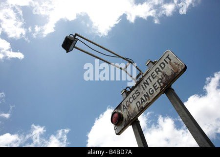 Aged warning sign and spotlight at a side entrance of the  European Space Agency's Spaceport at Malmanoury Creek, - Stock Photo