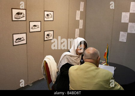 A new futuristic car concept is awaiting investment by a lady Iranian entrepreneur at an inventors fair at Alexandra - Stock Photo