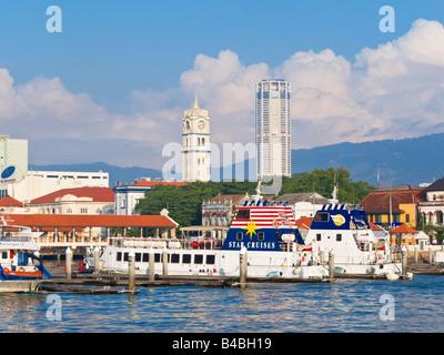 Asia, Malaysia, Penang, Pulau Pinang, Georgetown, City skyline and Victoria Memorial Clock Tower - Stock Photo