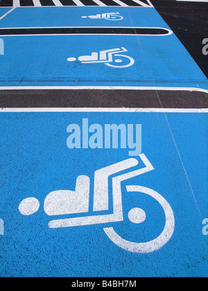 Handicap / disabled  parking space on a french supermarket - Stock Photo