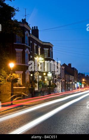The Swan Inn and Tarporley High Street at Night, Tarporley, Cheshire, England, UK - Stock Photo