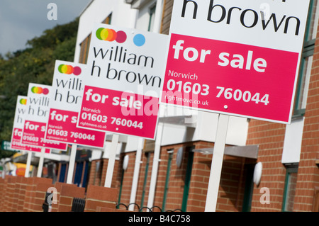 estate agents signs outside residential property - Stock Photo