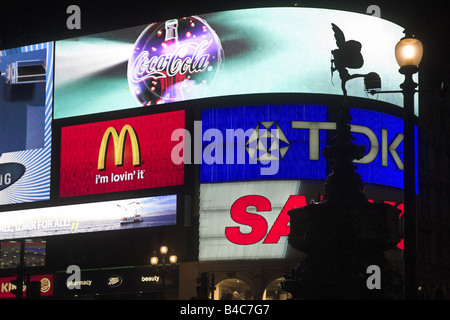 Silhoutte of Eros Statue in front of billboard, Piccadilly Circus, London, England, UK - Stock Photo