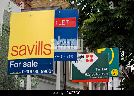 estate agent signs showing flats to let and for sale in putney, southwest london, england - Stock Photo