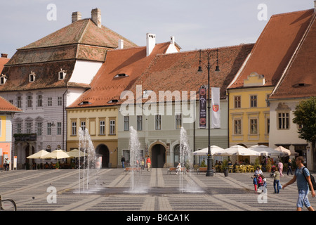 Sibiu Transylvania Romania Europe Old buildings and fountains in Piata Mare in historic city centre of Hermannstadt - Stock Photo