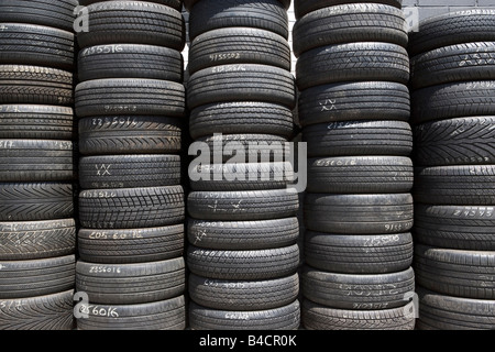Tires , used tires, tread, transportation, rubber, old, pile, scrap, retread, disrepair, repaired, outdoors, tire, - Stock Photo