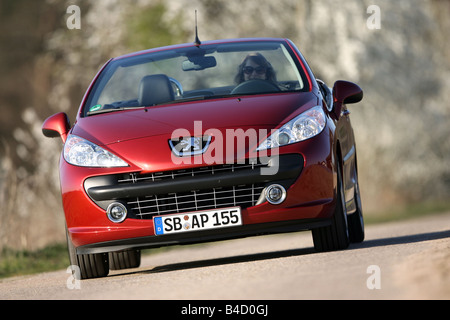 Peugeot 207 CC, model year 2007-, red, driving, diagonal from the front, frontal view, country road, open top - Stock Photo