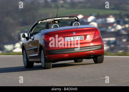 Peugeot 207 CC, model year 2007-, red, driving, diagonal from the back, rear view, country road, open top - Stock Photo