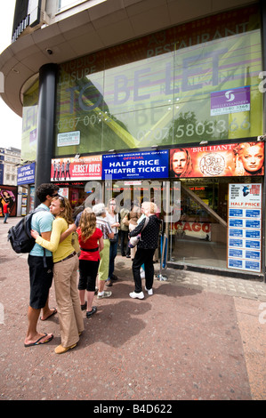 People in queue to buy theatre tickets, London, UK - Stock Photo