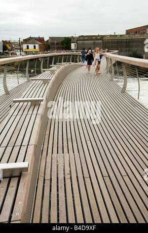 UK Yorkshire Castleford Grand Designs Big Town Plan people on new footbridge over River Aire - Stock Photo