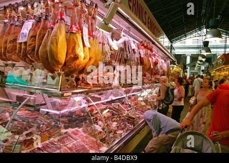 a meat stall on the la boqueria market in barcelona,spain - Stock Photo