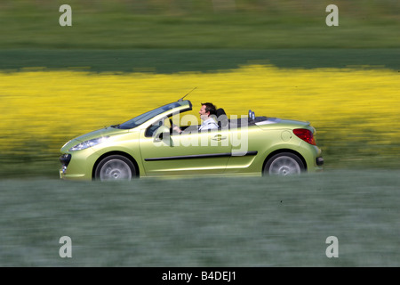 Peugeot 207 CC 120 Sport, model year 2007-, green, driving, side view, country road, open top - Stock Photo