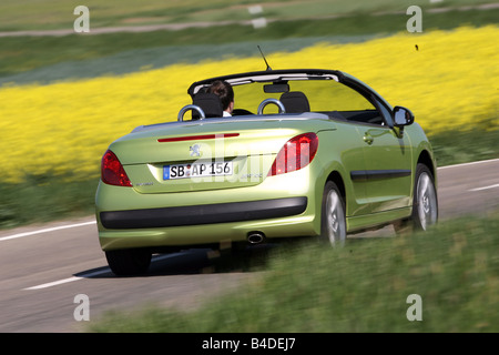 Peugeot 207 CC 120 Sport, model year 2007-, green, driving, diagonal from the back, rear view, country road, open - Stock Photo