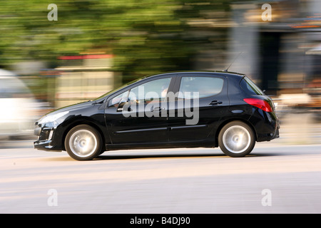 Peugeot 308 HDi FAP 135 Sport Plus, model year 2007-, black, driving, side view, City - Stock Photo