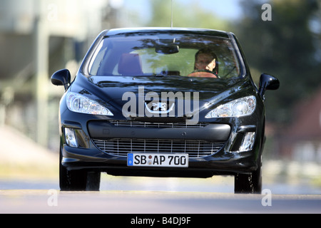 Peugeot 308 HDi FAP 135 Sport Plus, model year 2007-, black, driving, diagonal from the front, frontal view, City - Stock Photo