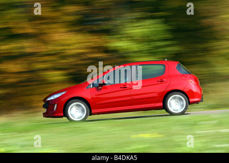 Peugeot 308 150 THP Sport Plus, model year 2007-, red, driving, side view, country road - Stock Photo
