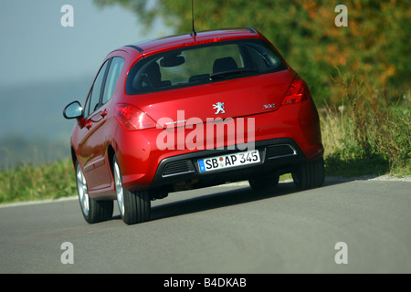 Peugeot 308 150 THP Sport Plus, model year 2007-, red, driving, diagonal from the back, rear view, country road - Stock Photo