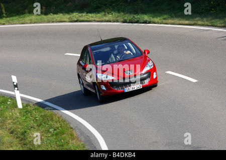 Peugeot 308 150 THP Sport Plus, model year 2007-, red, driving, diagonal from the front, frontal view, country road - Stock Photo