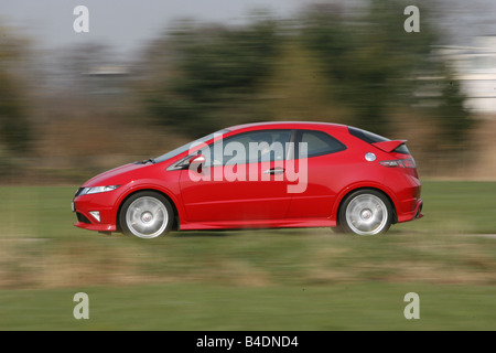 Honda Civic Type R, model year 2008-, red, driving, side view, country road - Stock Photo