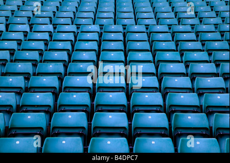 Rows of empty blue seats in a sports stadium - Stock Photo