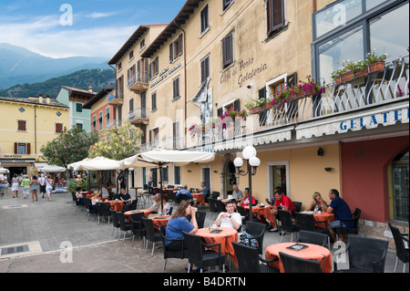 Cafe on the harbourfront in the old town, Malcesine, Lake Garda, Italy - Stock Photo