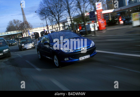 Car, Peugeot 206 CC, Convertible, model year 2000-, blue, open top, driving, City, diagonal from the front, Paris - Stock Photo