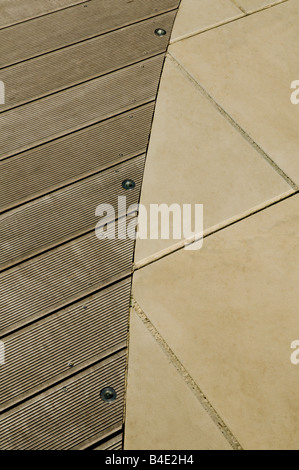 decking meets paving in modern garden - Stock Photo