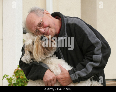 An old man and his dog - Stock Photo