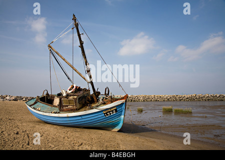 Boat on Morecambe sands at low tide Morecambe Lancashire England UK - Stock Photo