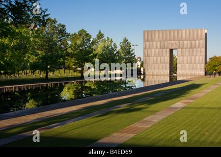 Oklahoma City, Oklahoma, USA. National Terrorism Memorial, Gate and Reflecting Pool. - Stock Photo