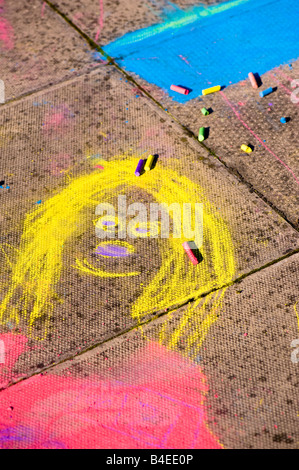 Child's  chalk drawing on pavement - Stock Photo