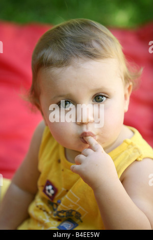 Cute happy one year old baby looking up - Stock Photo