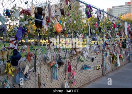 Oklahoma City, Oklahoma, USA. OKC National Memorial Mementos on Fence, Toys, Dolls, Clothing of those lost in the - Stock Photo