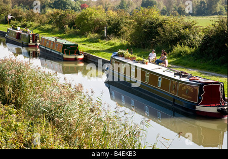 Narrowboats moored along the towpath on the Kennet and Avon canal at All Cannings in Wiltshire, England, Great Britain, - Stock Photo